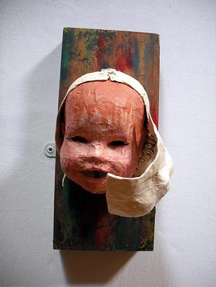 Doll's head on wooden block